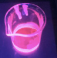 beaker of highly fluorescent CdSe/ZnS QDs